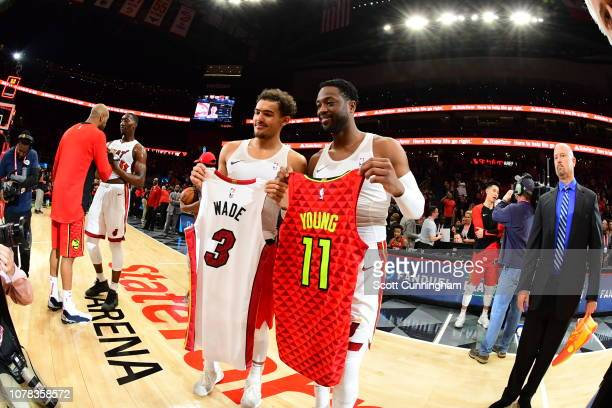 Dwyane Wade of the Miami Heat and Trae Young of the Atlanta Hawks exchange their jerseys after a game on January 6 2019 at State Farm Arena in...