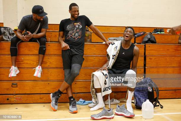 Dwyane Wade of the Miami Heat and Victor Oladipo of the Indiana Pacers react during NBA Offseason training with Remy Workouts on August 9 2018 in...
