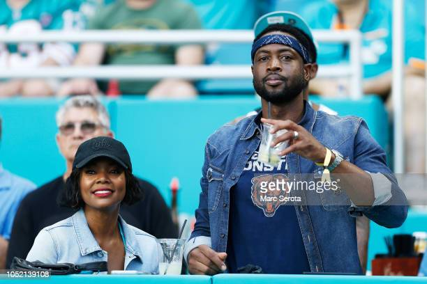 Dwyane Wade of the Miami Heat and wife and actress Gabrielle Union attend the game between the Miami Dolphins and Chicago Bears at Hard Rock Stadium...