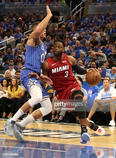 Dwyane Wade of the Miami Heat attempts to drive past Aaron Gordon of the Orlando Magic during the game at Amway Center on October 17 2018 in Orlando...