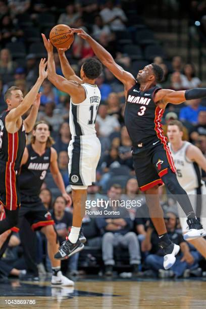 Dwyane Wade of the Miami Heat block shot attempt of Bryn Forbes of the San Antonio Spurs in a Preseason game at ATT Center on September 30 2018 in...