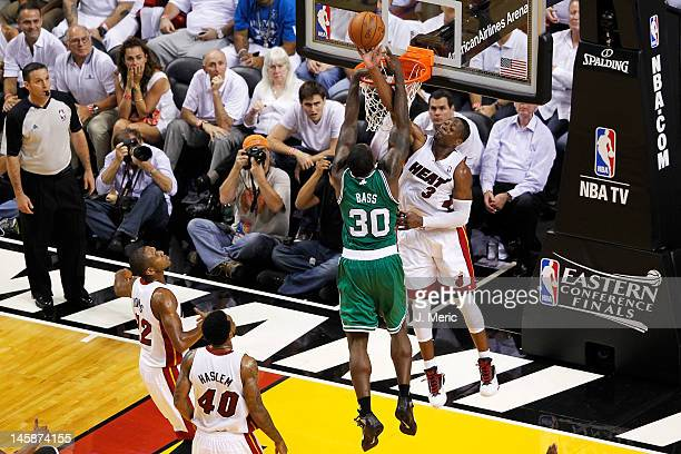 Dwyane Wade of the Miami Heat blocks a shot attempt by Brandon Bass of the Boston Celtics in Game Five of the Eastern Conference Finals in the 2012...