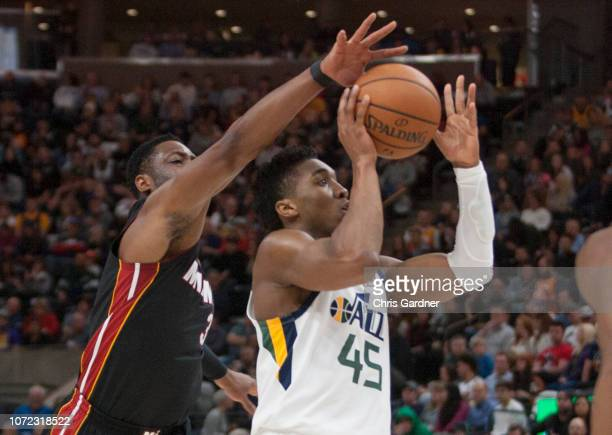 Dwyane Wade of the Miami Heat blocks a shot by Donovan Mitchell during their game at the Vivint Smart Home Arena on December 12 2018 in Salt Lake...