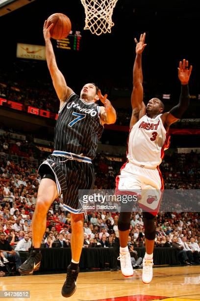 Dwyane Wade of the Miami Heat blocks against JJ Redick of the Orlando Magic on December 17 2009 at American Airlines Arena in Miami Florida NOTE TO...
