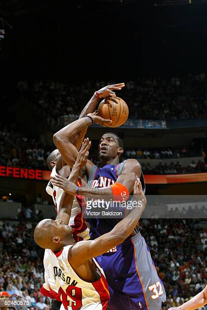 Dwyane Wade of the Miami Heat blocks Amare Stoudemire of the Phoenix Suns which leads to a cross court buzzer beater on March 25 2005 at American...