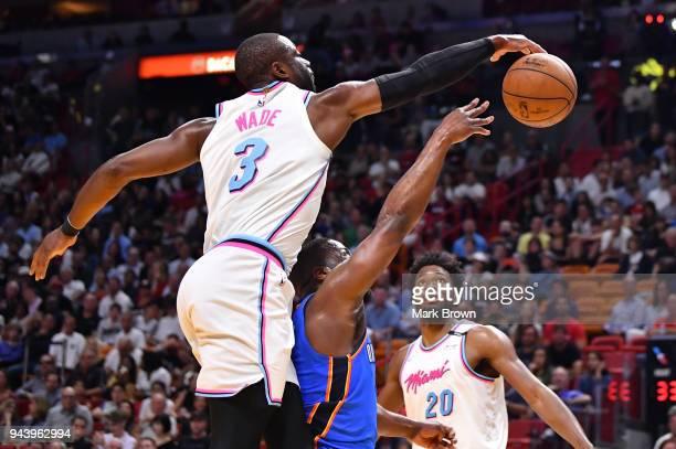 Dwyane Wade of the Miami Heat blocks Raymond Felton of the Oklahoma City Thunder during the game between the Miami Heat and the Oklahoma City Thunder...
