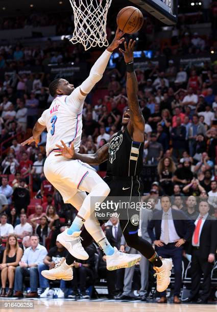 Dwyane Wade of the Miami Heat blocks the shot of Eric Bledsoe of the Milwaukee Bucks during the fourth quarter of the game at American Airlines Arena...