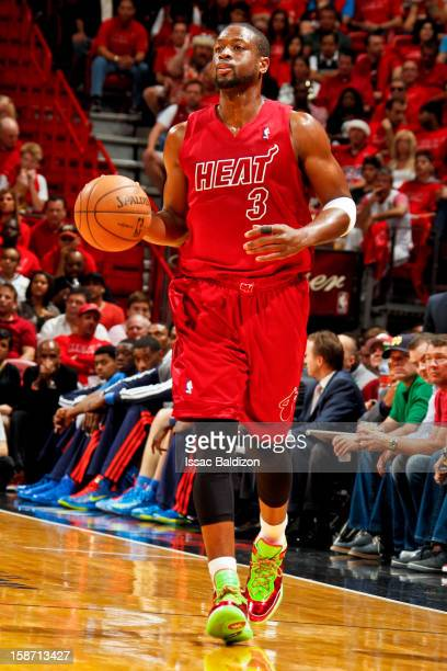Dwyane Wade of the Miami Heat brings the ball up court against the Oklahoma City Thunder during a Christmas Day game on December 25 2012 at American...