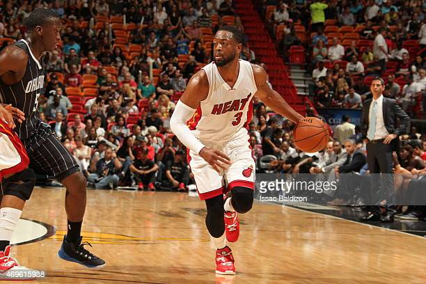 Dwyane Wade of the Miami Heat brings the ball up court against against the Orlando Magic on April 13 2015 at American Airlines Arena in Miami Florida...