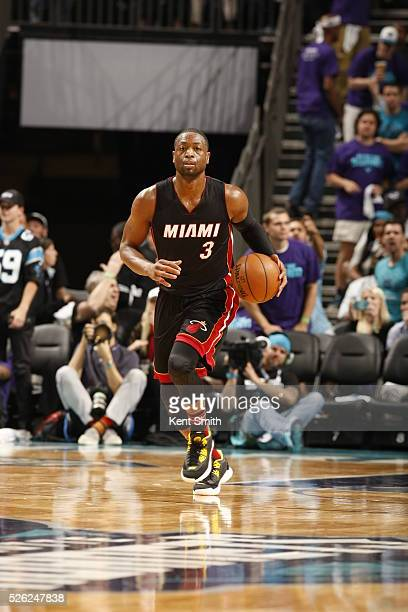 Dwyane Wade of the Miami Heat brings the ball up court against the Charlotte Hornets in Game Six of the Eastern Conference Quarterfinals during the...
