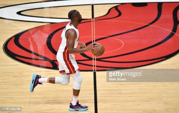 Dwyane Wade of the Miami Heat brings the ball up the court in the first half against the Charlotte Hornets at American Airlines Arena on March 17...
