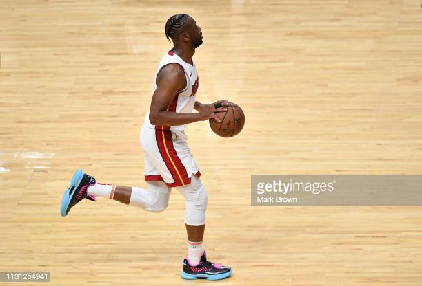 Dwyane Wade of the Miami Heat brings the ball up the court in the second half against the Charlotte Hornets at American Airlines Arena on March 17...