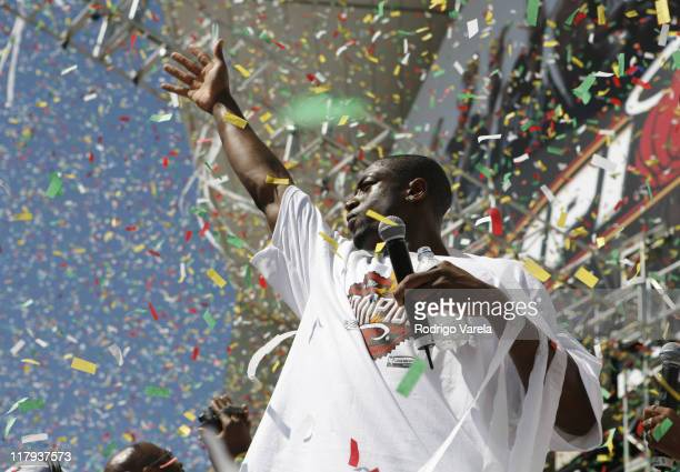 Dwyane Wade of the Miami Heat celebrate during the victory parade and celebration at American Airlines Arena on June 23 2006 in Miami Florida
