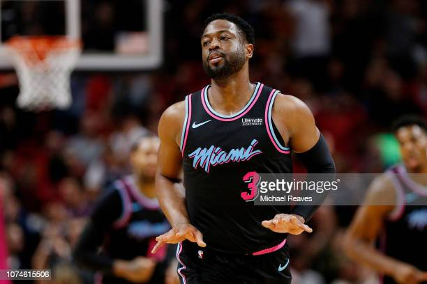 Dwyane Wade of the Miami Heat celebrates a basket in the closing minute against the Milwaukee Bucks during the second half at American Airlines Arena...