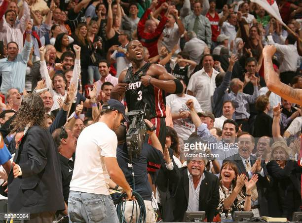 Dwyane Wade of the Miami Heat celebrates a victory over the Chicago Bulls on March 9 2009 at the American Airlines Arena in Miami Florida NOTE TO...