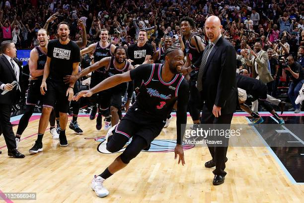 Dwyane Wade of the Miami Heat celebrates after hitting a gamewinning three pointer against the Golden State Warriors at American Airlines Arena on...