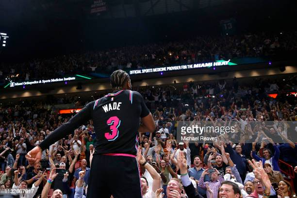 Dwyane Wade of the Miami Heat celebrates after hitting a game-winning three pointer against the Golden State Warriors at American Airlines Arena on...