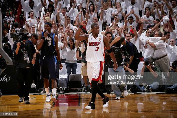Dwyane Wade of the Miami Heat celebrates the Heat's 98-96 win against the Dallas Mavericks during Game Three of the 2006 NBA Finals June 13, 2006 at...