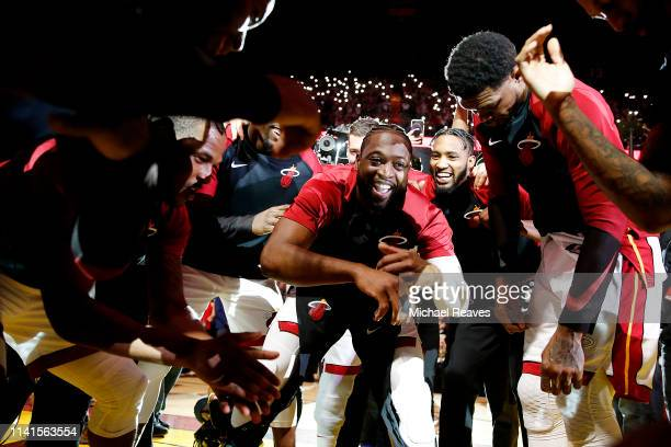 Dwyane Wade of the Miami Heat celebrates with teammates prior to the game between the Philadelphia 76ers and the Miami Heat at American Airlines...