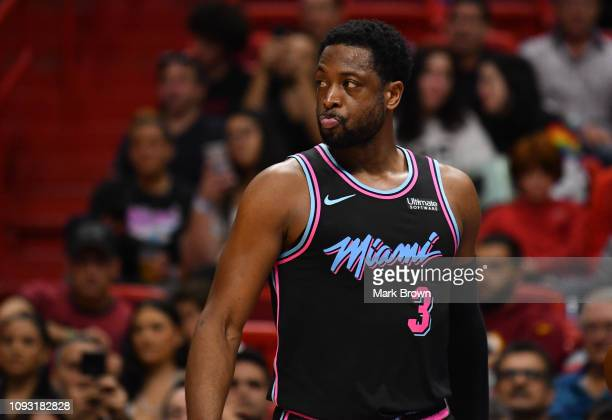 Dwyane Wade of the Miami Heat checks his face for injury against the Indiana Pacers during the first half at American Airlines Arena on February 2...