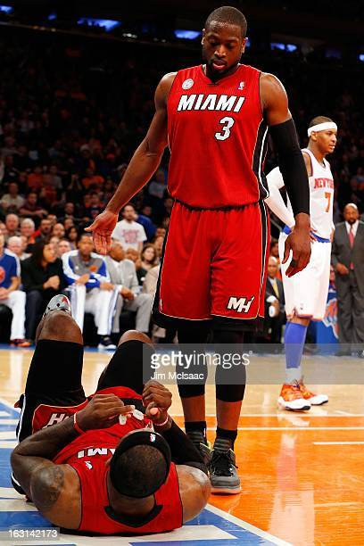 Dwyane Wade of the Miami Heat checks on teammate LeBron James after a fall against the New York Knicks at Madison Square Garden on March 3 2013 in...