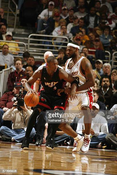 Dwyane Wade of the Miami Heat dribbles against LeBron James of the Cleveland Cavaliers at Quicken Loans Arena on April 1 2006 in Cleveland Ohio The...