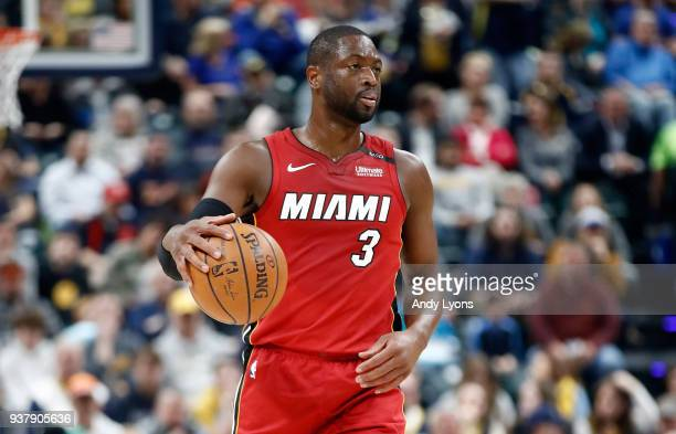 Dwyane Wade of the Miami Heat dribbles the ball against the Indiana Pacers during the game at Bankers Life Fieldhouse on March 25 2018 in...