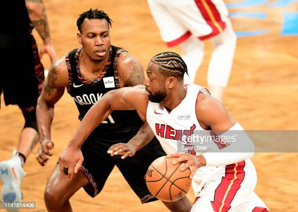 Dwyane Wade of the Miami Heat dribbles the ball against Treveon Graham of the Brooklyn Nets during the second half of the game at Barclays Center on...