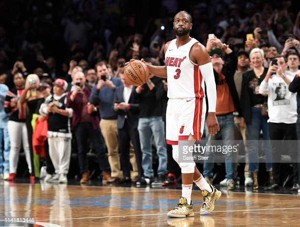 Dwyane Wade of the Miami Heat dribbles the ball in the final seconds of the second half of the game against the Brooklyn Nets at Barclays Center on...