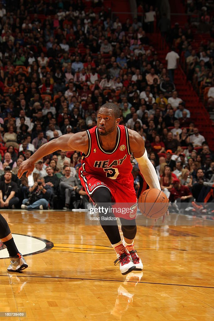 Dwyane Wade #3 of the Miami Heat dribbles the ball up the court against the Charlotte Bobcats during a game on February 4, 2013 at American Airlines Arena in Miami, Florida.