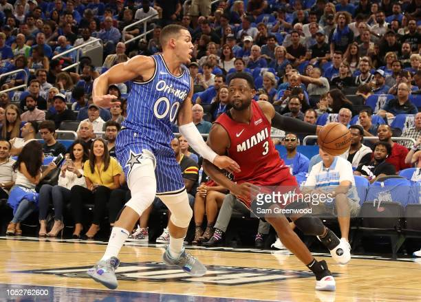 Dwyane Wade of the Miami Heat drives against Aaron Gordon of the Orlando Magic during the game at Amway Center on October 17 2018 in Orlando Florida...