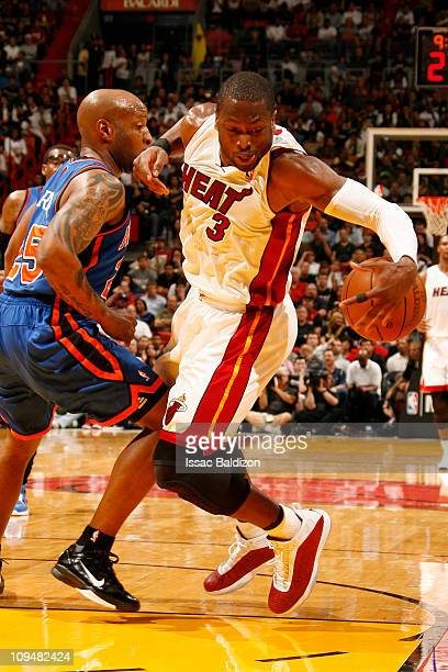 Dwyane Wade of the Miami Heat drives against Anthony Carter of the New York Knicks on February 27 2011 at American Airlines Arena in Miami Florida...