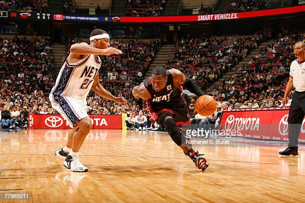 Dwyane Wade of the Miami Heat drives against Antoine Wright of the New Jersey Nets on November 17 2007 at the IZOD Center in East Rutherford New...
