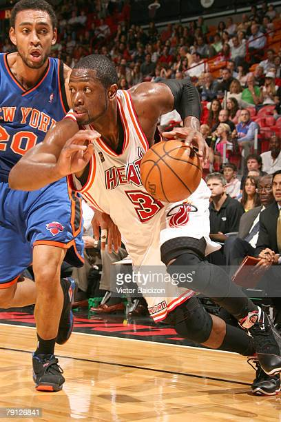 3458065d402 Dwyane Wade of the Miami Heat drives against Jared Jeffries of the New York  Knicks on