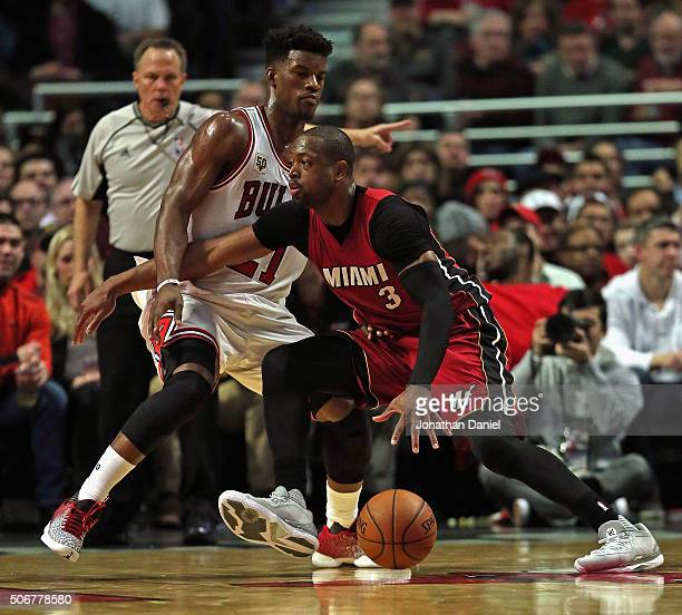 Dwyane Wade of the Miami Heat drives against Jimmy Butler of the Chicago Bulls at the United Center on January 25 2016 in Chicago Illinois The Heat...