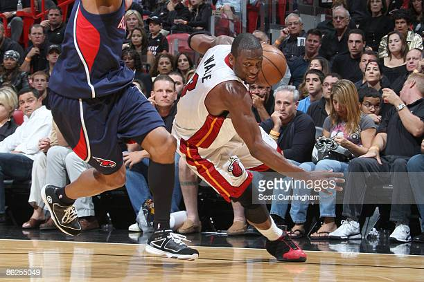 Dwyane Wade of the Miami Heat drives against the Atlanta Hawks in Game Four of the Eastern Conference Quarterfinals during the 2009 NBA Playoffs at...