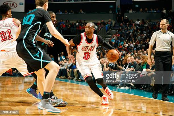 Dwyane Wade of the Miami Heat drives against the Charlotte Hornets during the game at the Time Warner Cable Arena on February 05 2016 in Charlotte...