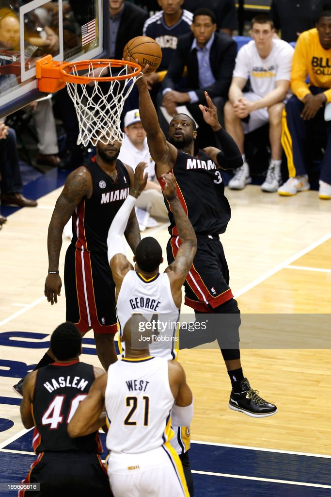 Dwyane Wade #3 of the Miami Heat drives for a shot attempt in the secon dhalf against Paul George #24 of the Indiana Pacers during Game Four of the Eastern Conference Finals of the 2013 NBA Playoffs at Bankers Life Fieldhouse on May 28, 2013 in Indianapolis, Indiana.