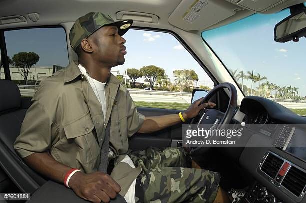 Dwyane Wade of the Miami Heat drives his Range Rover to the American Airlines Arena March 20 2005 in Miami Florida NOTE TO USER User expressly...