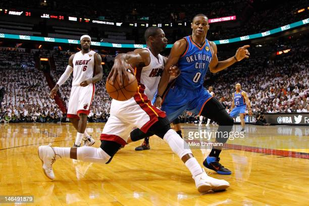 Dwyane Wade of the Miami Heat drives in the first hallf against Russell Westbrook of the Oklahoma City Thunder in Game Three of the 2012 NBA Finals...