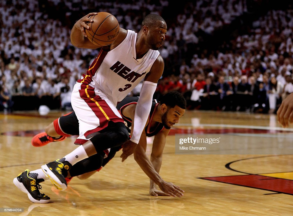 Dwyane Wade #3 of the Miami Heat drives on Cory Joseph #6 of the Toronto Raptors during Game 4 of the Eastern Conference Semifinals of the 2016 NBA Playoffs at American Airlines Arena on May 9, 2016 in Miami, Florida.