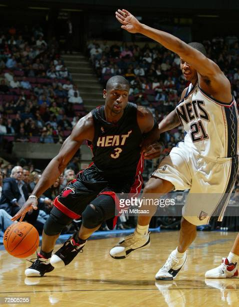 Dwyane Wade of the Miami Heat drives past Antoine Wright of the New Jersey Nets during their game on November 10, 2006 at Continental Airlines Arena...