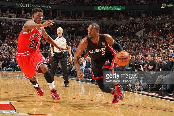 Dwyane Wade of the Miami Heat drives past Jimmy Butler of the Chicago Bulls on March 27 2013 at the United Center in Chicago Illinois NOTE TO USER...