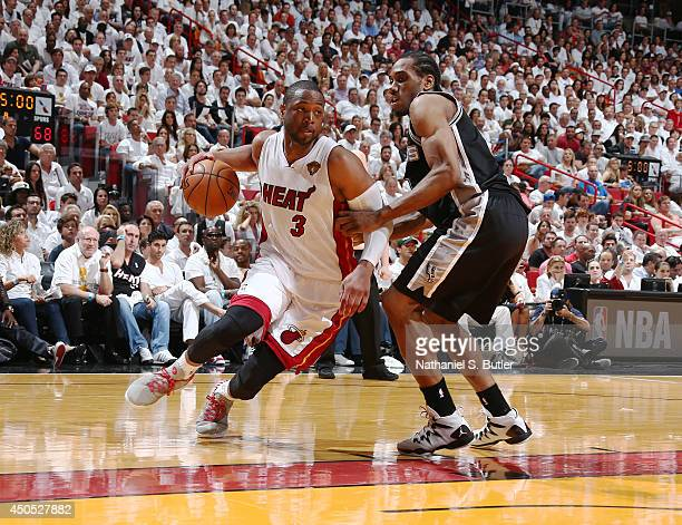 Dwyane Wade of the Miami Heat drives past Kawhi Leonard of the San Antonio Spurs during Game Four of the 2014 NBA Finals at American Airlines Arena...