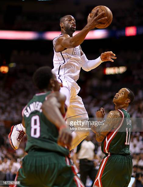 Dwyane Wade of the Miami Heat drives past Monta Ellis of the Milwaukee Bucks during Game 2 of the Eastern Conference Quarterfinals of the 2013 NBA...