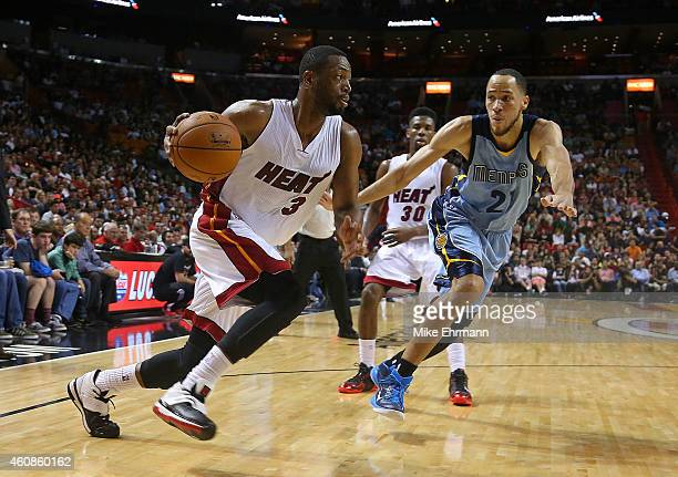 Dwyane Wade of the Miami Heat drives past Tayshaun Prince of the Memphis Grizzlies during a game at American Airlines Arena on December 27 2014 in...