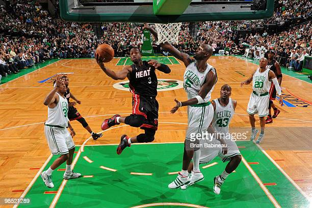 Dwyane Wade of the Miami Heat drives the lane against Kevin Garnett of the Boston Celtics in Game One of the Eastern Conference Quarterfinals during...