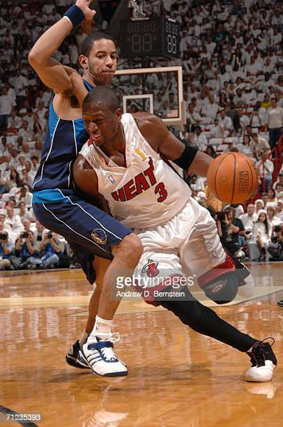 Dwyane Wade of the Miami Heat drives to the basket against Devin Harris of the Dallas Mavericks during Game Five of the 2006 NBA Finals on June 18...
