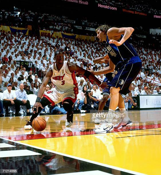 Dwyane Wade of the Miami Heat drives to the basket against Dirk Nowitzki of the Dallas Mavericks during game three of the 2006 NBA Finals played June...