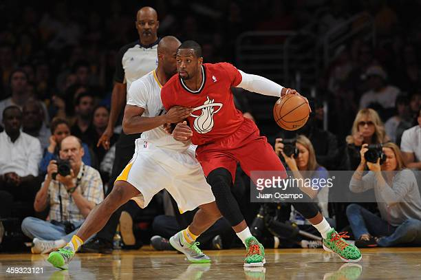 Dwyane Wade of the Miami Heat drives to the basket against Jodie Meeks of the Los Angeles Lakers at STAPLES Center on December 25 2013 in Los Angeles...